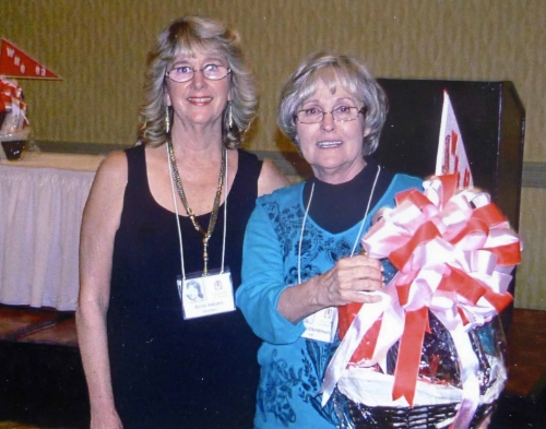 Anne Adams Goodwin presenting a raffle prize to Robin Hall.