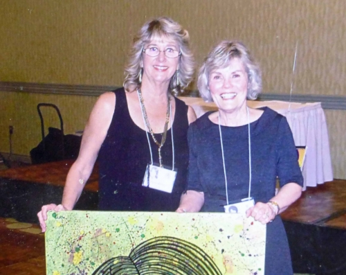 Kathy Trorey Long won a raffle prize (picture painted by Barry Bullard) presented by Anne Adams Goodwin.
